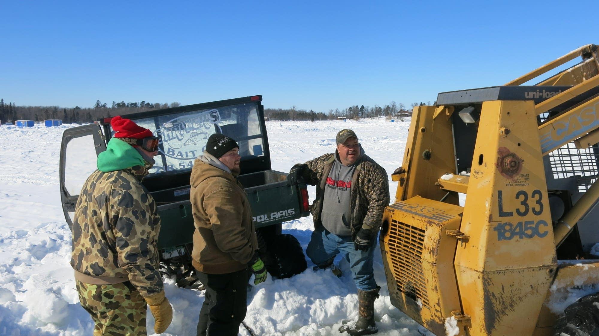 A skid-steer rescues Jack Shriver's stranded ATV.