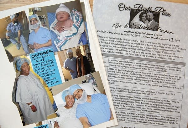 Photographs on a scrapbook page and laminated birth plan.