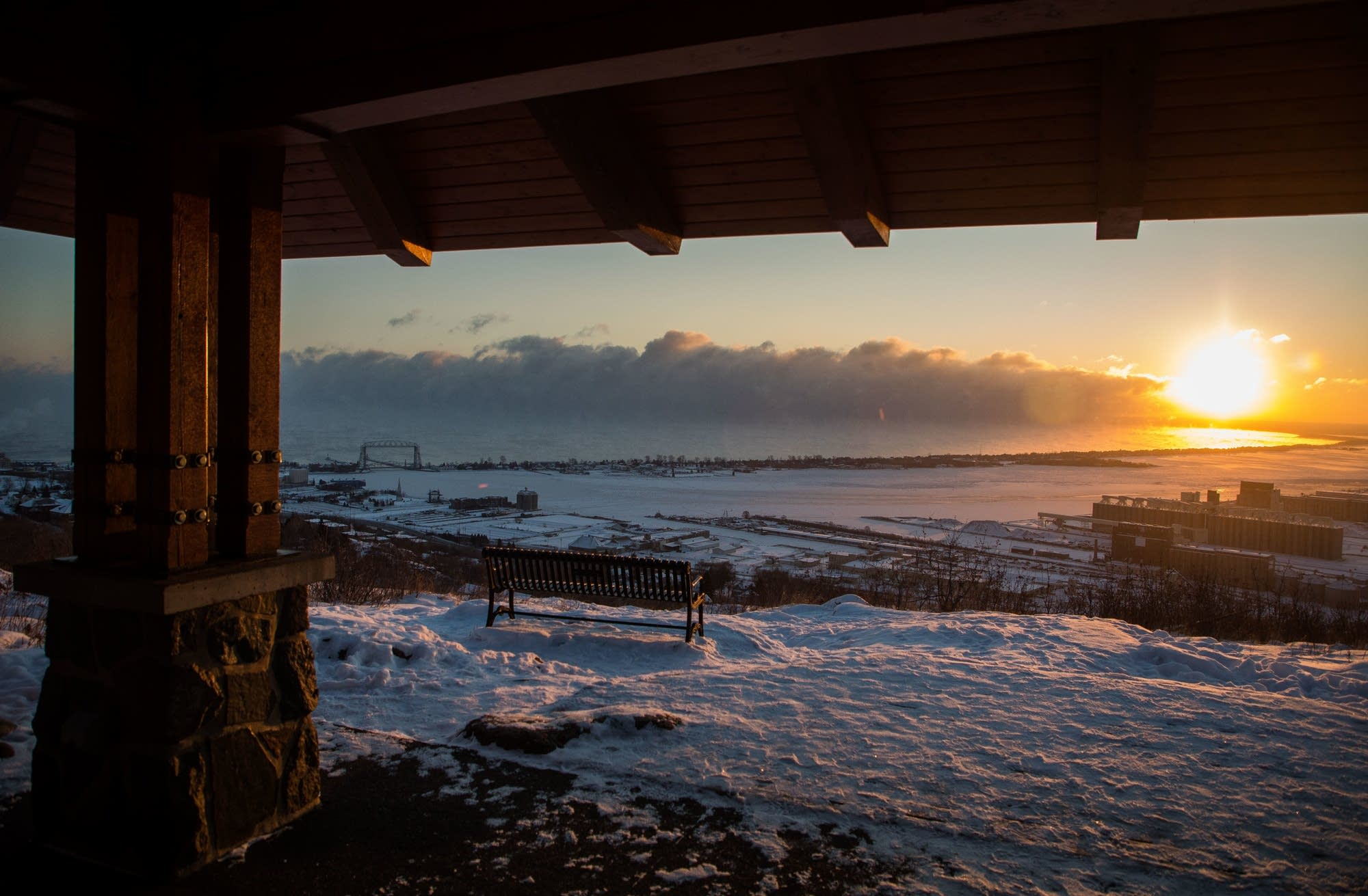 Sea smoke and the sun rise over Lake Superior and the Aerial Lift Bridge.