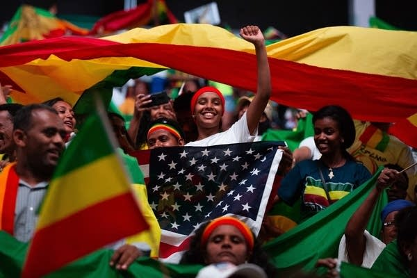 Supporters of Ethiopian Prime Minister Abiy Ahmed cheer.