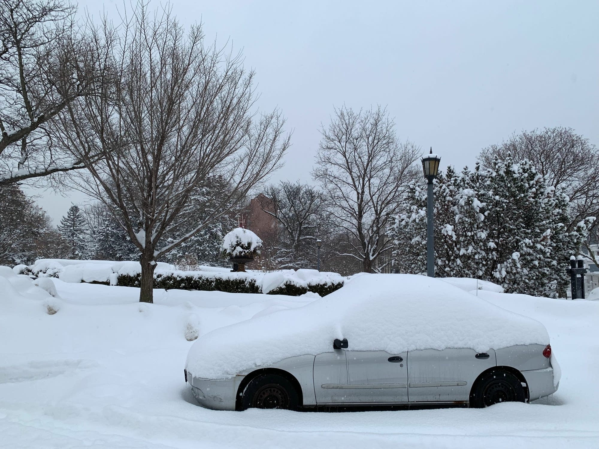 A car is parked on a street in Minneapolis Wednesday.