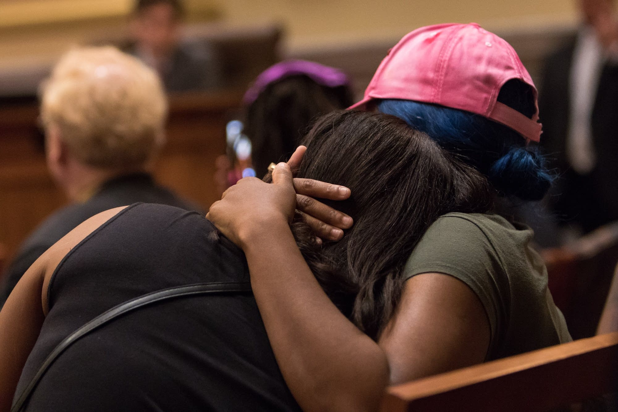 Two of Thurman Blevins family members comfort each other.
