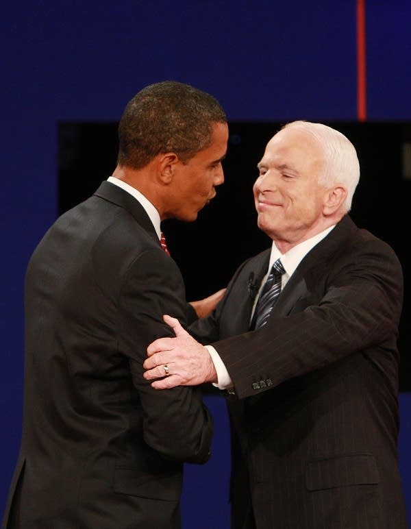 The candidates greet each other on stage