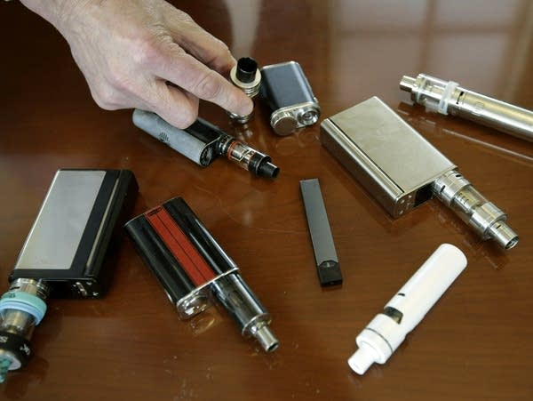 Vaping devices are displayed.