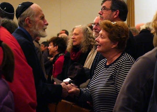During an interfaith vigil at Mt. Zion Temple.
