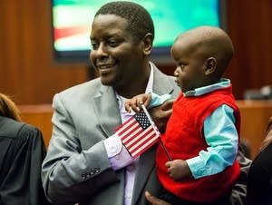Tiberious Mose holds his son, Keegan.