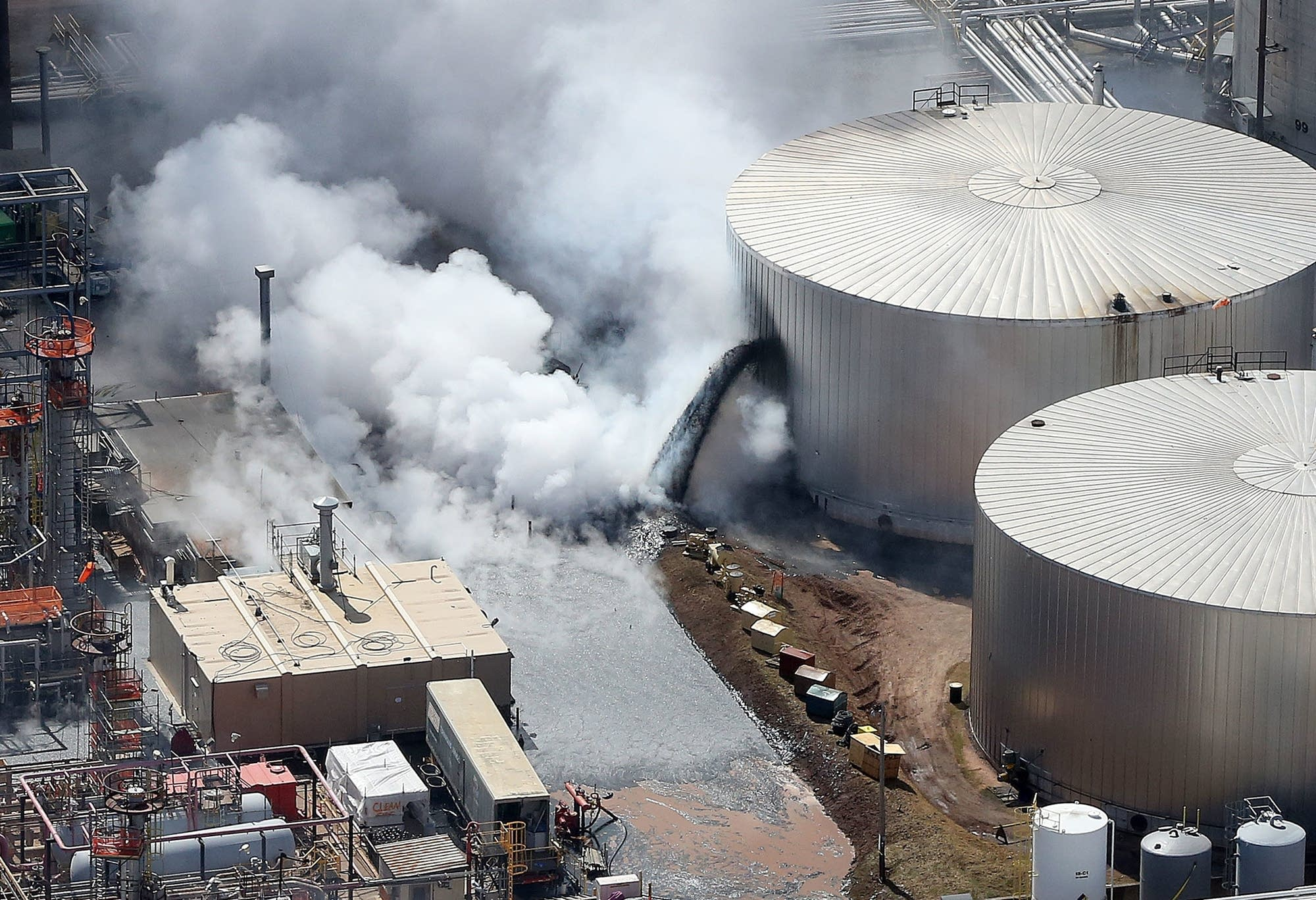 Black liquid pours from a ruptured tank as seen from the air Thursday a.m.