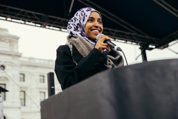 Ilhan Omar speaks to the crowd.