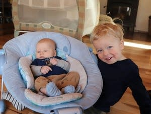 Zein Ibrahim, left, poses for a picture with his baby brother, Fen.