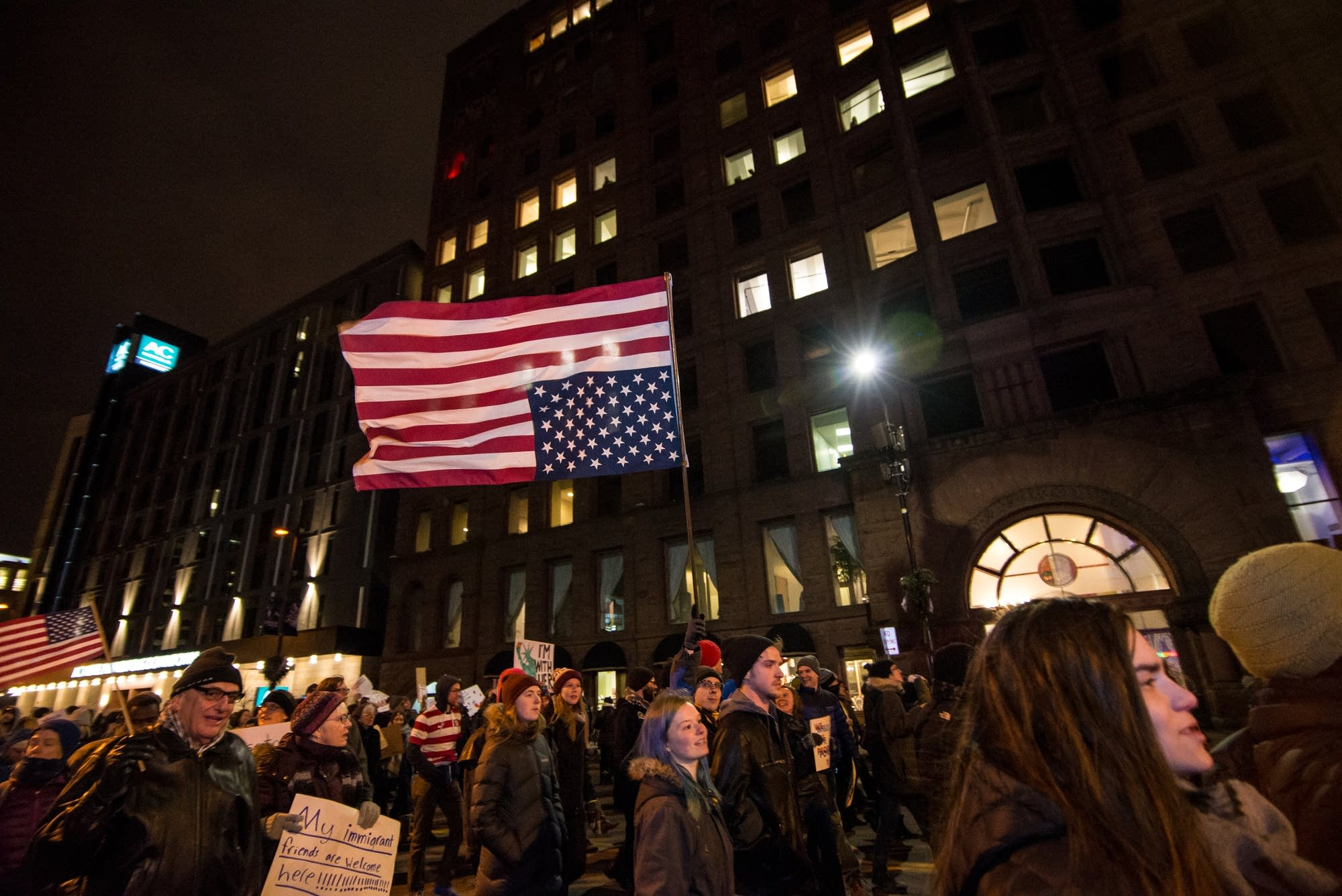 A protester flies an American flag upside down