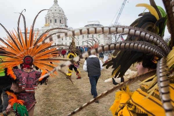 Indigenous dancers lead a group of protesters to the Capitol.