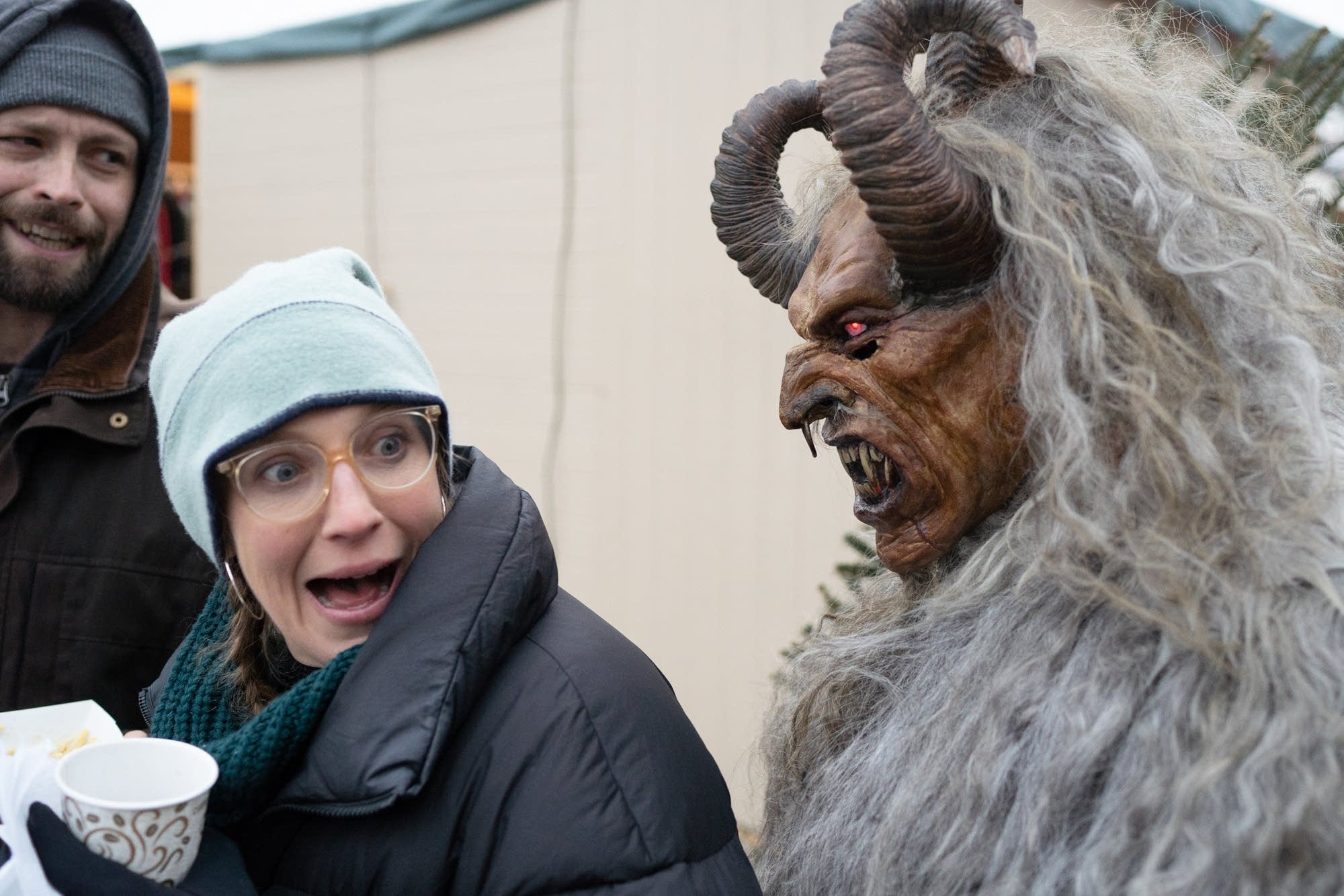 Ross Otto, dressed as Krampus, frightens Dylan Welch.
