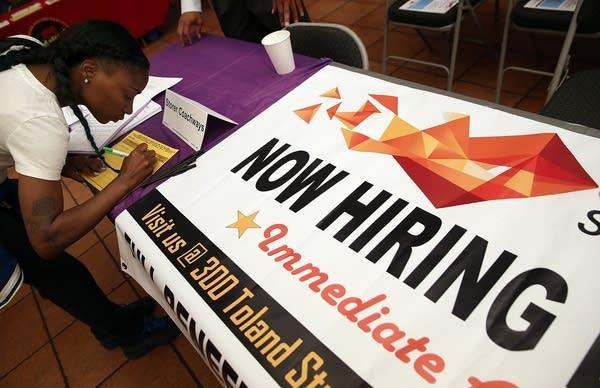 A job seeker fills out an application