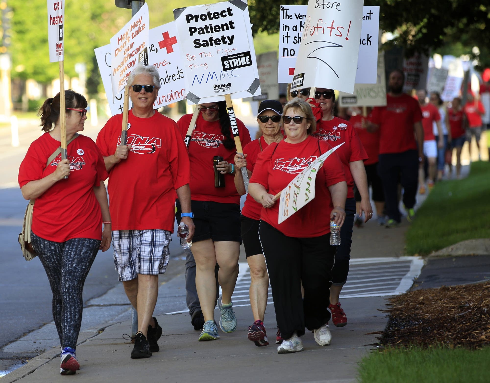 Striking nurses and supporters march.
