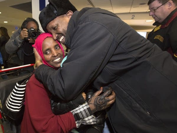 Mahamed Iye hugs his wife Saido Ahmed Abdille