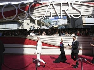 Media walk on the red carpet before the Oscars