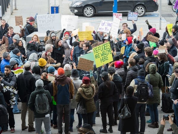 Protesters gather at JFK International Airport on January 28, 2017