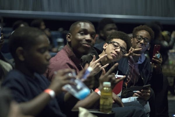 Guests of the WEQY Black Panther movie premiere pose for the camera.