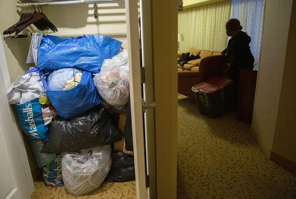 Plastic bags stacked in a hotel room.
