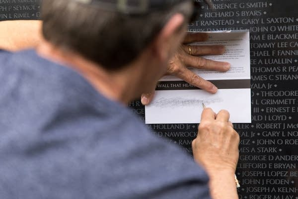 Bill Bandelin traces the name of Vietnam veteran Kenneth V. Goodman.