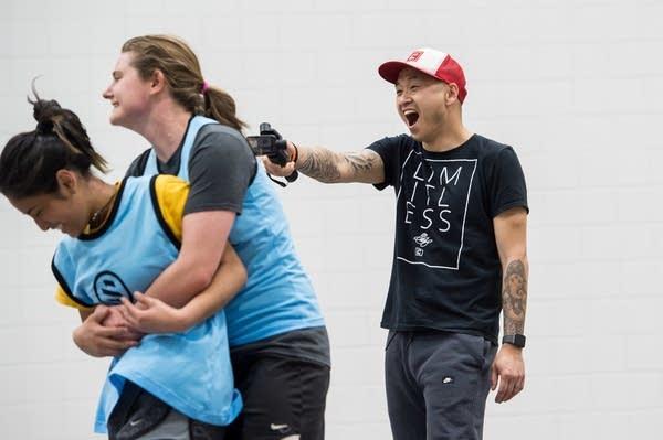 Coaches Kyle Johnson and Jennifer Larrick react to Valentina Millio's goal.