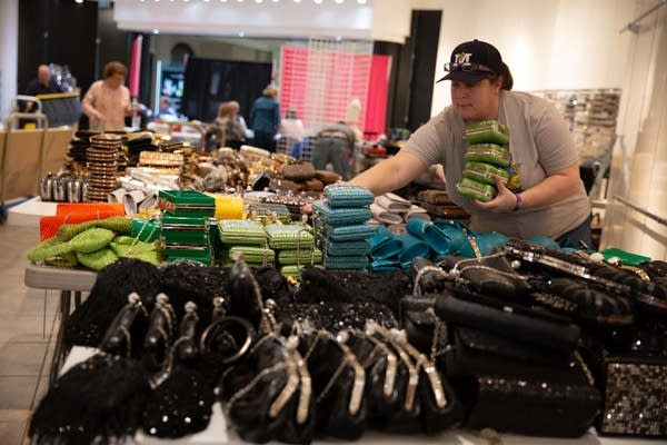 Heather Rowe sorts handbags to prepare for the princess event.