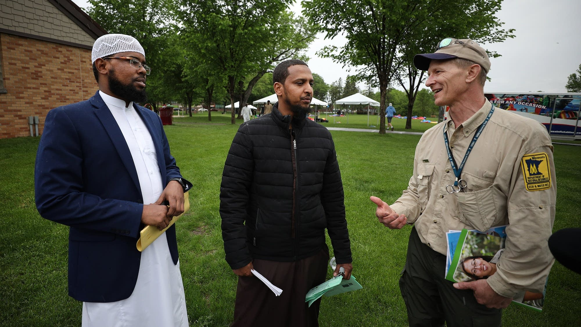 Ahmed Hassan and Mohayadin Mohamed talk with Mark Hauck.