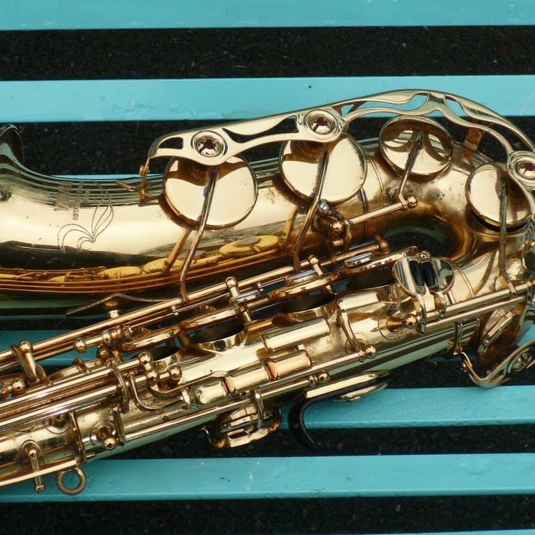Saxophone on blue metal bench