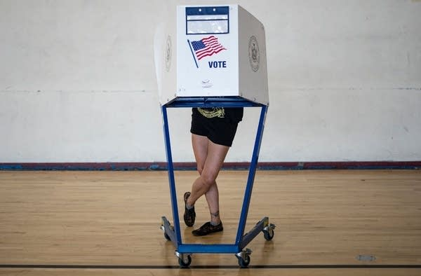 A woman votes at a polling site in New York.