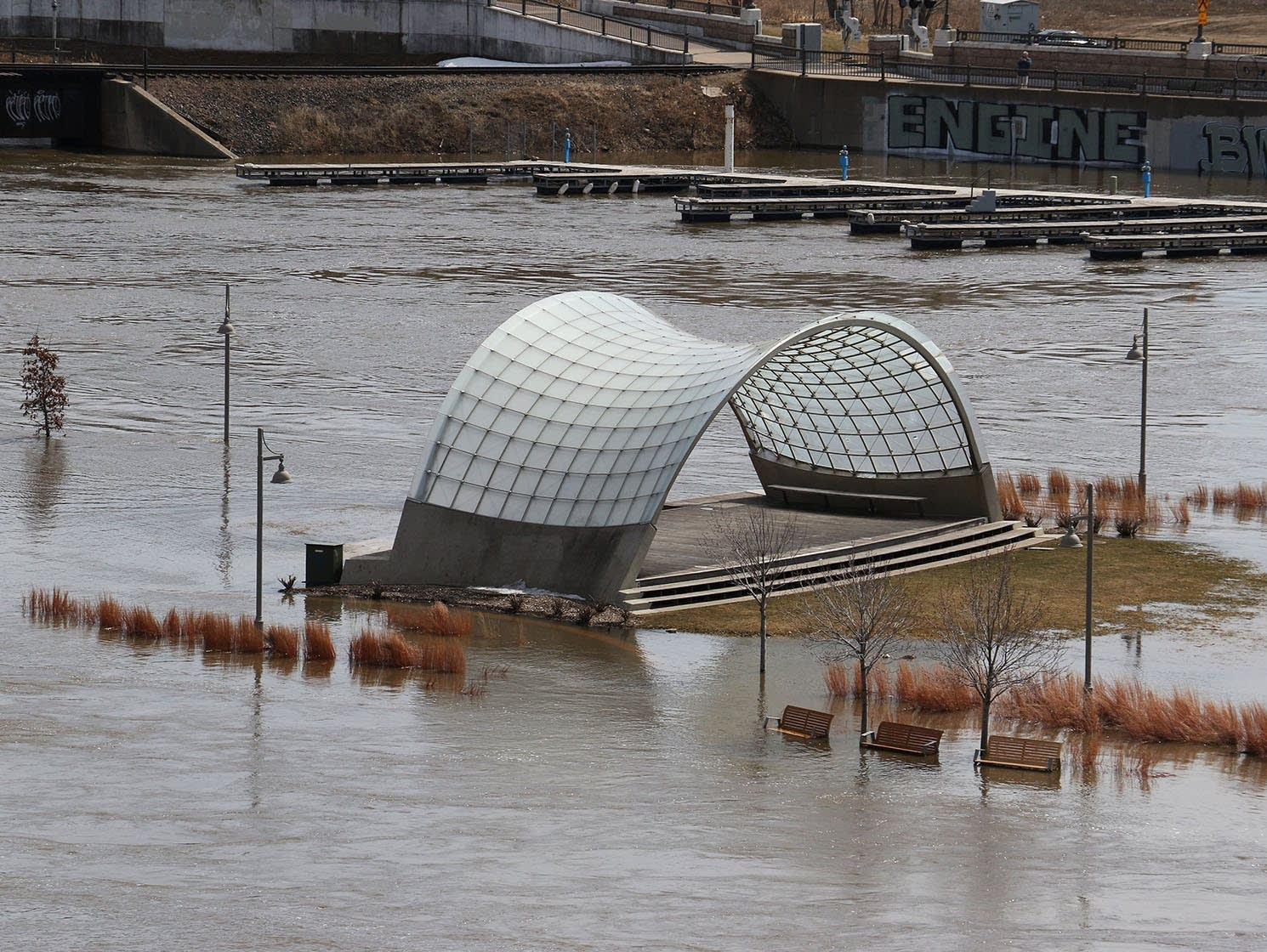 Mississippi River floodwaters surround the Raspberry Island band shell