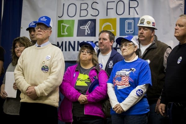 Supporters of Twin Metals listen to speakers