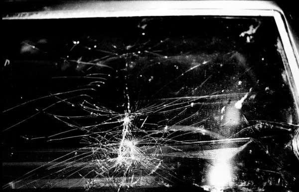 Shattered windshield of squad car