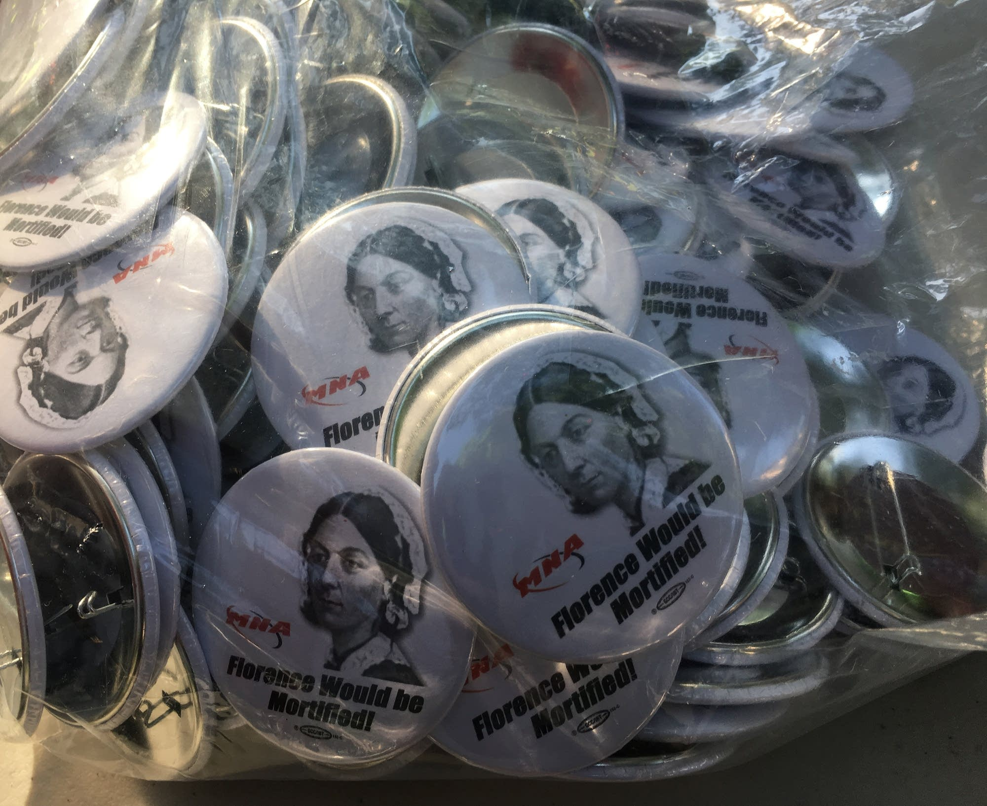 Buttons at the staging ground for the strike