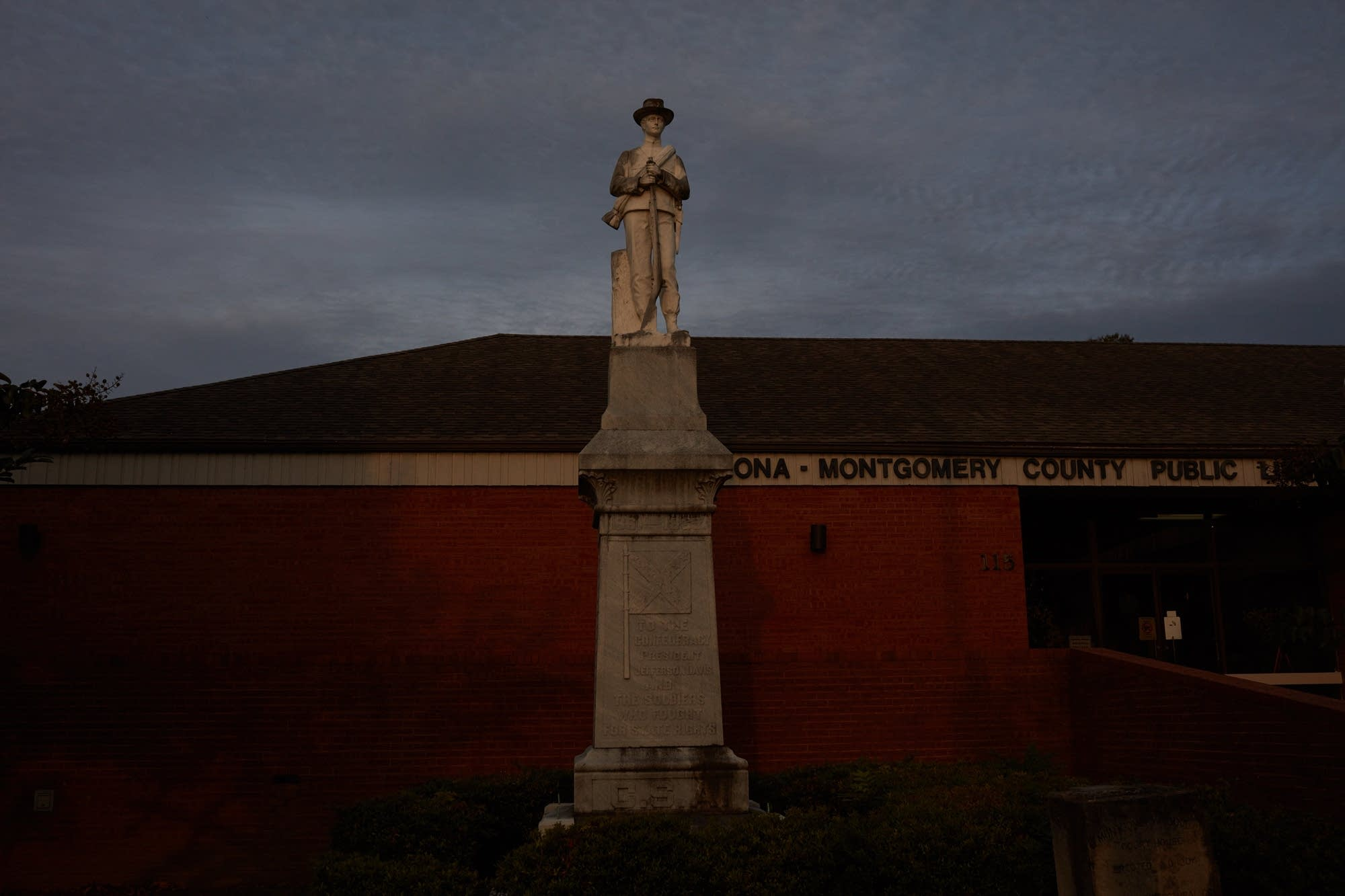 A Confederate statue in front of the Winona Public Library building.