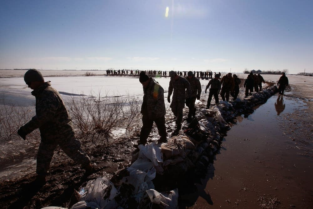 National Guard members march to help sandbag