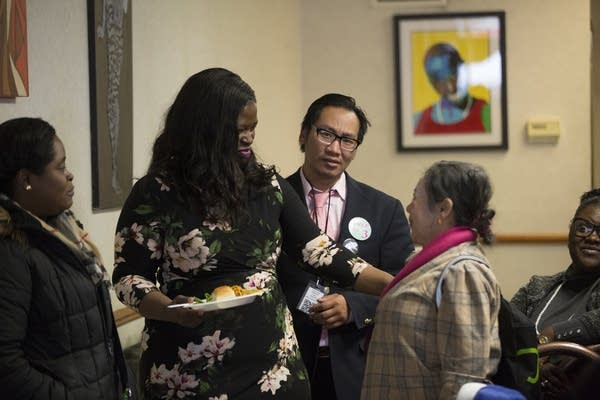Nekima Levy-Pounds talks with people at Sammy's Avenue Eatery.