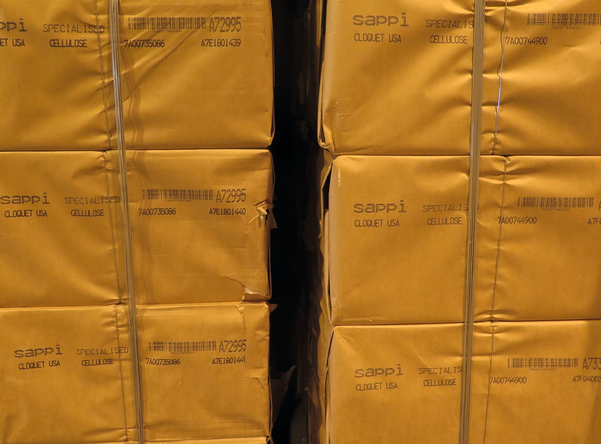 Bales of specialized cellulose wait to be shipped overseas.