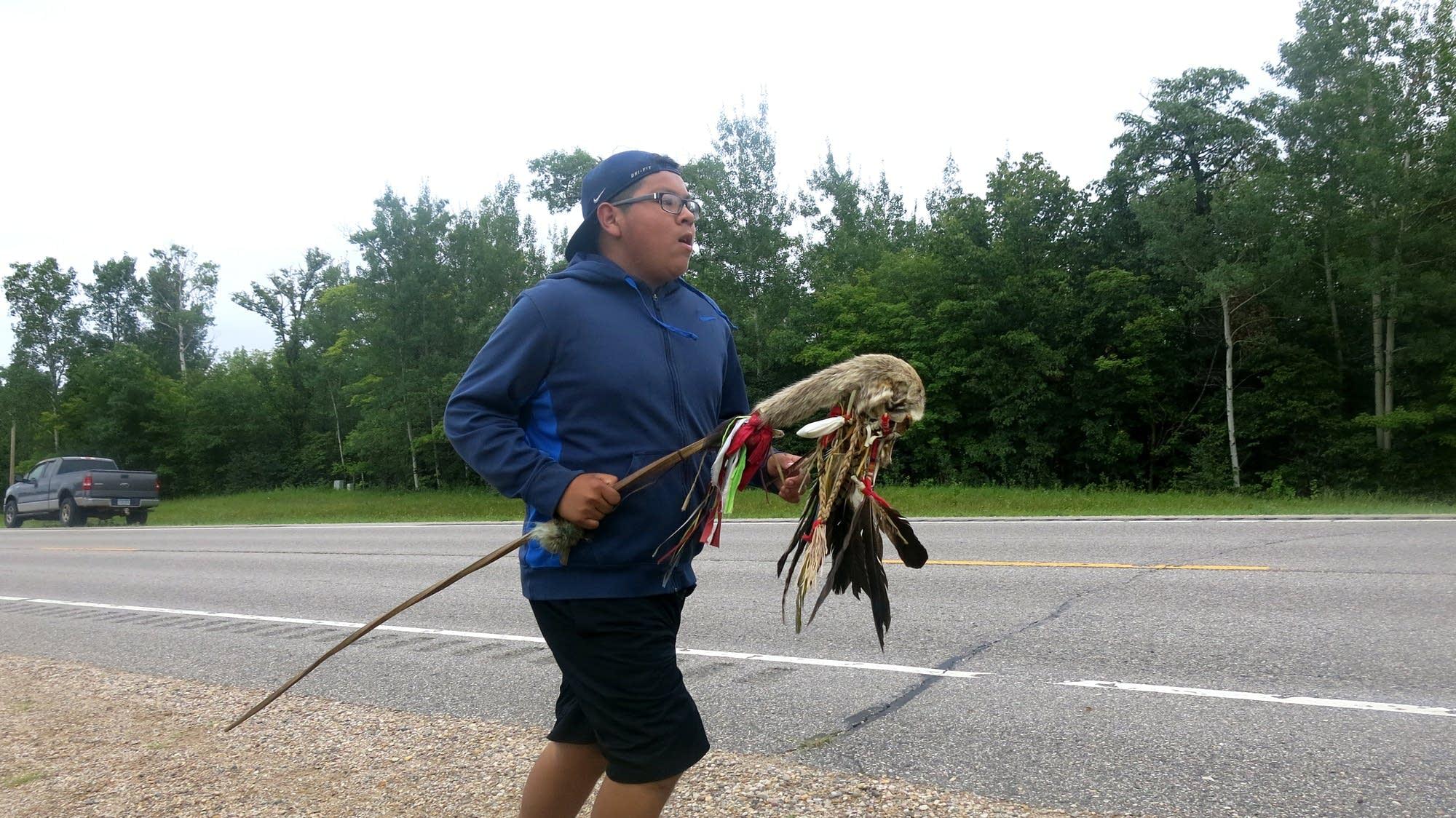 Michael Sumner runs along Highway 89.