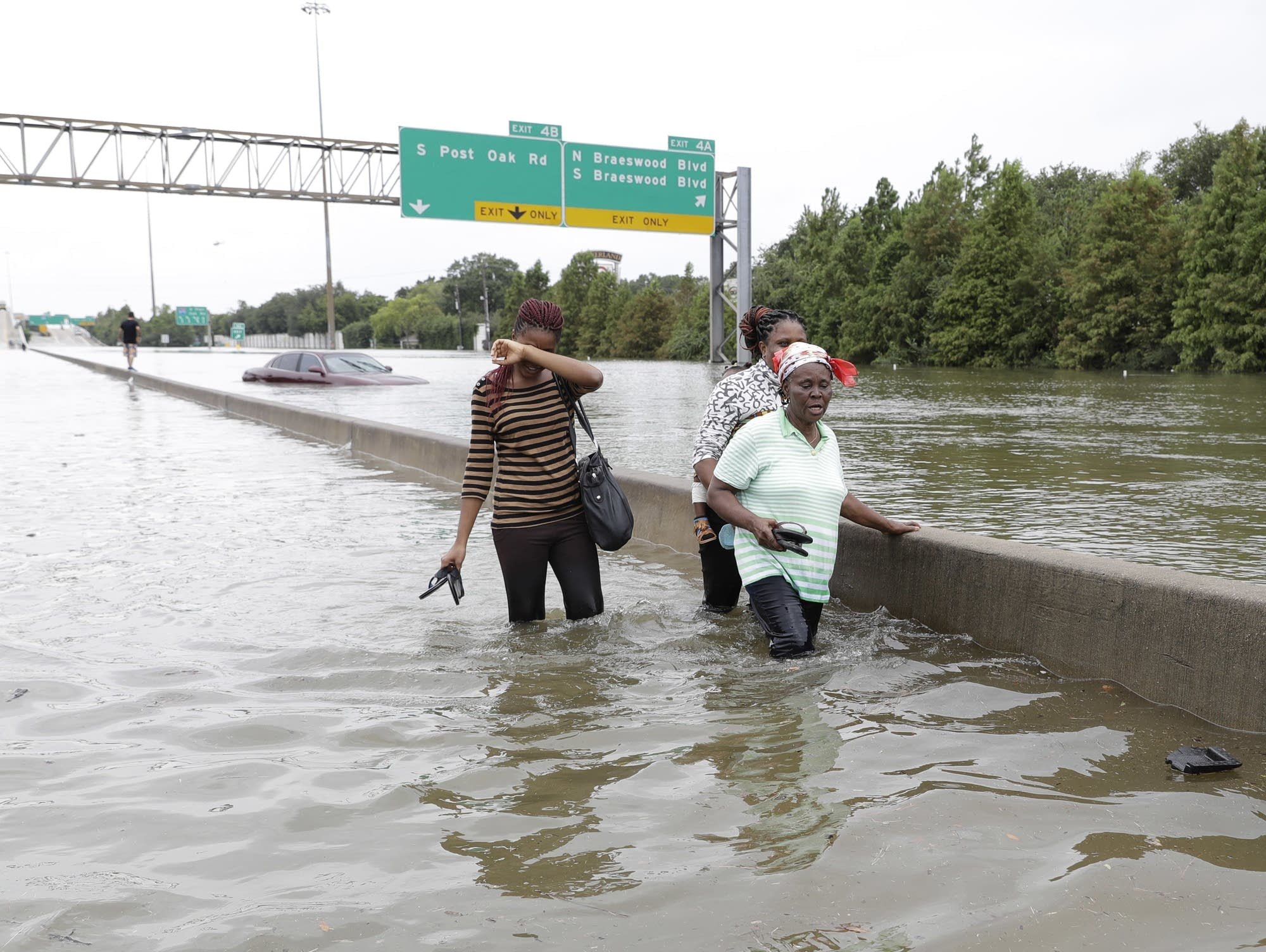 Catastrophic floods strike Houston; thousands flee homes ...