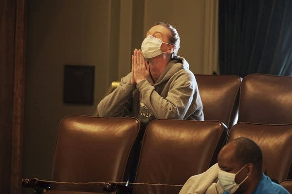 A woman reacts after a bill passed in the state House.