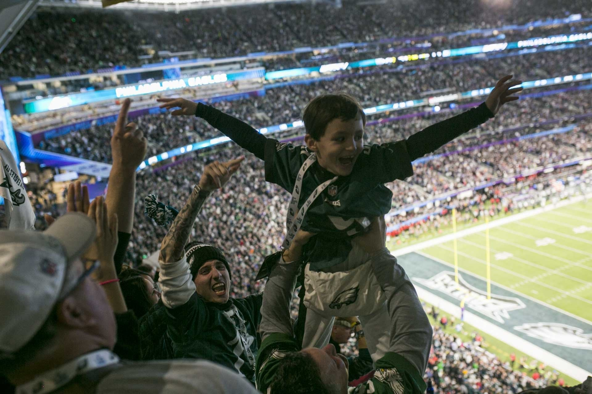 Philadelphia fans hoist a child into the air