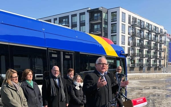 Gov. Tim Walz and officials attended the unveiling of the electric bus.
