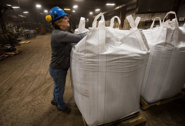 Peggy Wallgren Jones opens up a one ton bag of Bioapt.