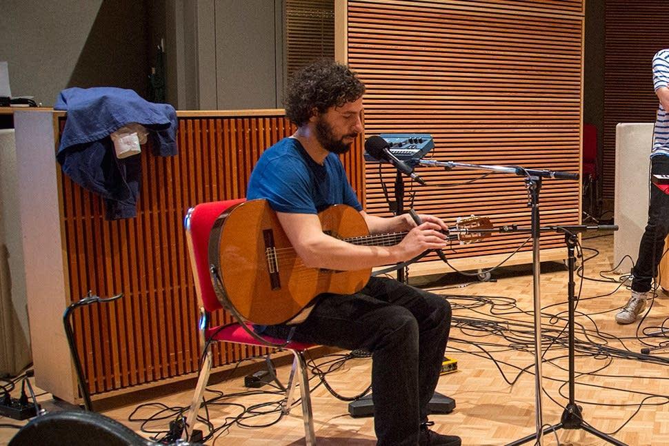 Jose Gonzalez adjusts microphone