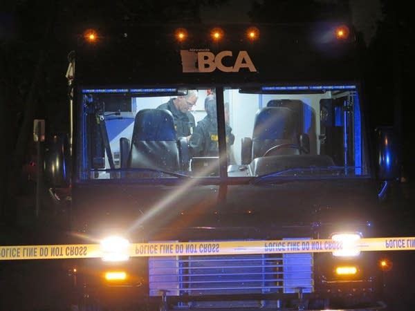 BCA personnel on the scene of a shooting by a St. Paul Police officer.
