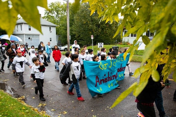 Anishinabe Academy students march in an Indigenous People's Day parade.