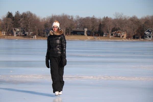Amy Nelson skates on Lake Minnetonka