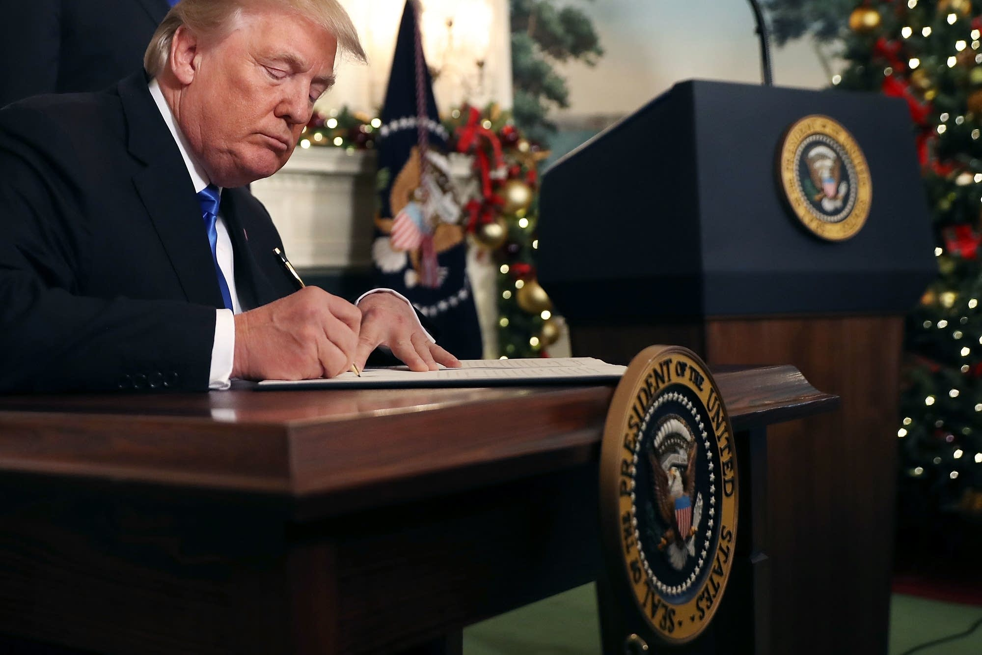 President Donald Trump signs a proclamation on Jerusalem.
