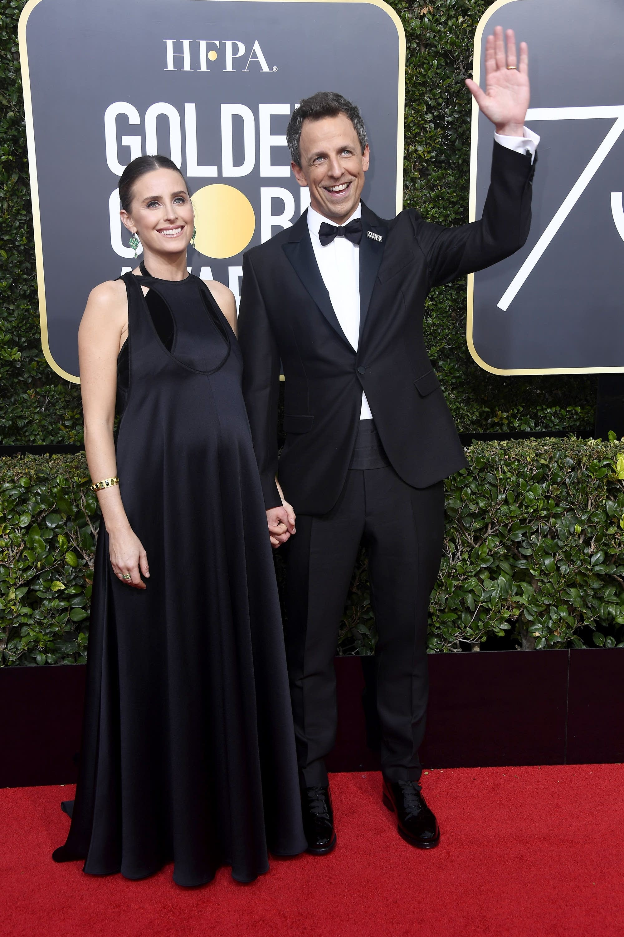 Alexi Ashe Meyers and Seth Meyers arrive at the Golden Globes.