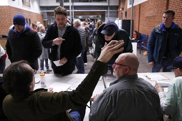Caucusgoers check in at a caucus.